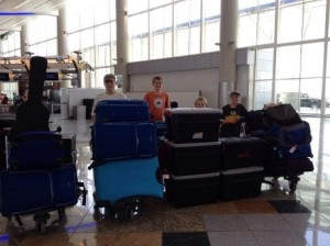 At the Atlanta airport with our luggage.  Between everyone in our group there were over 150 pieces!