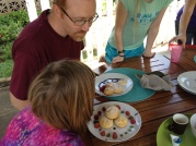 Deciding which plate of cream puffs is best!